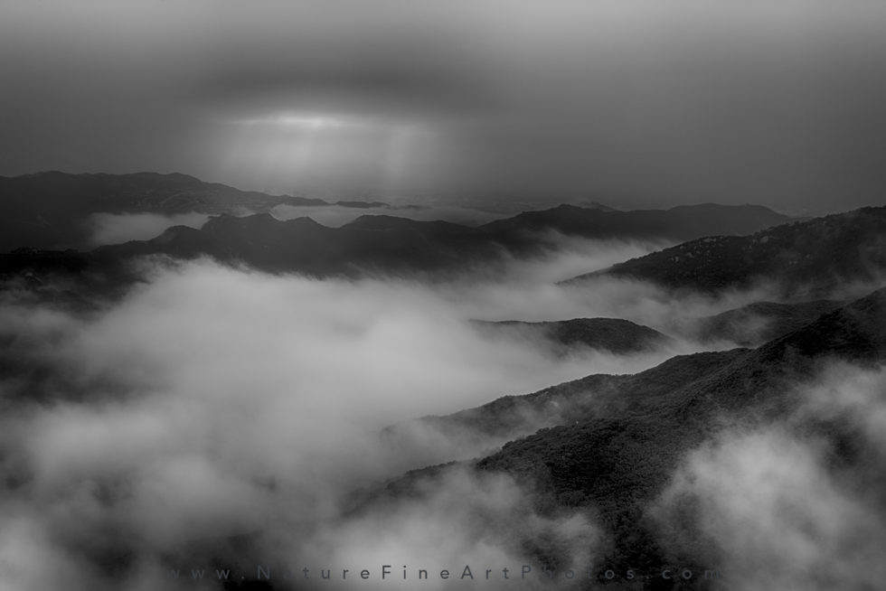 black and white photo of clouds over santa monica mountains
